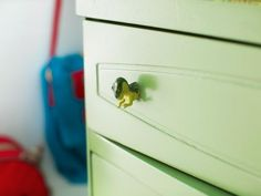 The experts at HGTV.com share step-by-step instructions on how to update a dresser with repurposed toys.