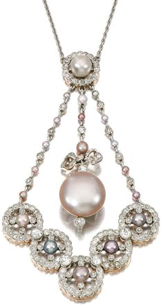 Natural pearl and diamond pendant necklace, Early 20th Century. Set with variously coloured natural pearls, millegrain set with circular- and single-cut diamonds, length approximately 420mm. Via Sotheby's.
