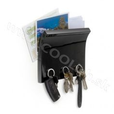 The Umbra Magnetter is a wall mounted organizer and key magnet that gives you a handy slot to throw your mail into, assuming you're not already on your way to the garbage, and it's also magnetic . Magnetic Key Holder, Key And Letter Holder, Key Storage, Wall Organization, Letter Wall, Cubbies, Hermes Kelly, High Gloss, Wall Mount