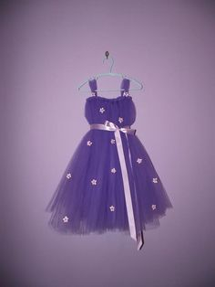 I am loving this purple tutu dress. I am also loving the cute flower accents. :) Adorable and whimsy!
