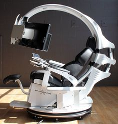 I'm In The Future!: $21,500 Computer Pod Work Station June 5, 2013 This is the MWE Labs Emperor 1510LX, a $21,500 computer workstation. It leans back, has a retractable monitor arm, moving leg rest, cup holder, and a bunch of other features that struggle to justify its $21,500 price tag (although that cup holder does cover about $10,000 of it). Did I mention you have to provide your own monitors?
