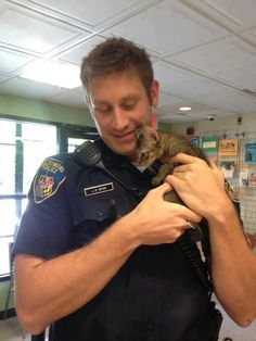 Love men who love cats. A tiny stray kitten found a Baltimore police officer to be his human dad for life. Man In Love, Cat Love, Crazy Cat Lady, Crazy Cats, Men With Cats, Hot Cops, Kitten Rescue, Men In Uniform, Cat People