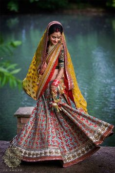 "#Indian_Wedding ""Love everything about this image from the playful mood of the bride, the stunning colors and the traditional #Lehenga!"""