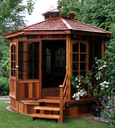 Red cedar gazebo that's full screened in. Perfect!!!!!  I would love to have this in my yard!!!