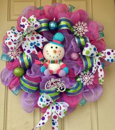 """WHIMSICAL SNOWMAN Christmas Wreath with the cutest snowman ever! This pastel colored wreath measures 24"""" x 24"""" with Christmas ornaments and glittered ribbon for only $55. Purchase here https://www.etsy.com/listing/476572166/pastel-colored-christmas-wreath-with"""