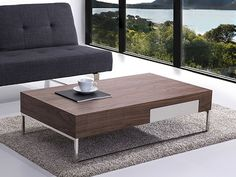 Stylish walnut stainless coffetable with a useful drawer