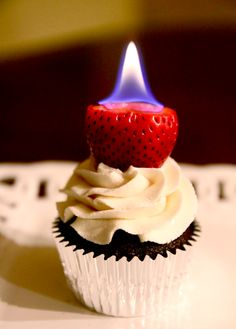 Flaming strawberry cupcakes These would be so awesome for good fella's on Valentine's Day. LOL