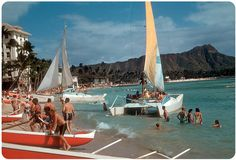 Waikiki Beach, Honolulu, Hawaii – 1959    Catamaran rides in front of the Moana Hotel. Diamond Head in the background.