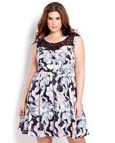 We have a thing for pink this season! Plus-size pastel pink and purple floral dress from Addition Elle