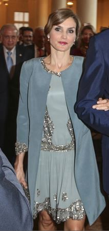 Queen Letizia of Spain is seen at the Miami-Dade College Presidential Medal presentation to her husband King Felipe VI of Spain at the Freedom Tower on September 17, 2015 in Miami, Florida.   Queen Letizia revived a silver-blue Felipe Varela duster coat and dress set worn in March 2012 to a friend's wedding.
