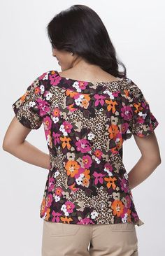Our popular Kathryn Top with this wild floral/camo print. Beautiful A-line top Two patch pockets Side slits Shirring at sleeves 100% Lightweight Cotton