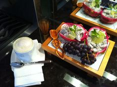 Matcha latte with homemade organic almond milk, dragon fruit with lime and local cincord grapes SNACK/lLUNCH