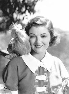 Myrna Loy and a feathered friend.