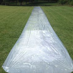 100 ft of house plastic available at any home improvement store + dish washing liquid and baby oil throw a water hose to it and you've got yourself some fun in the sun redneck slip-n-slide style