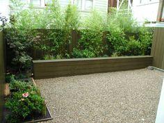 Trex Seat Wall and Fences, Bamboo, Gravel Bamboo Hedge, Bamboo Planter, Bamboo Garden, House Landscape, Garden Landscape Design, Landscape Designs, Gravel Landscaping, Modern Landscaping, Dutch Gardens