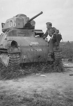 German non-commissioned officer in the armor downed French medium tank Somua S35. Registration number of the tank - 67236. The machine of the 2nd Platoon of the 3rd Squadron 4th Cavalry Regiment Kirasirsky 1st Light Mechanized Brigade 1st Light Mechanized Division.