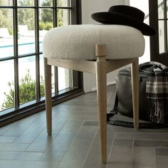 SMACKOVER- a stool of cerused oak and cotton. The ideal spot for tying one's shoes or sharing a conversation with a friend.  Quality.