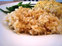 "Rice pilaf is one of my go-to side dishes. Hubs could eat the whole pan himself. There's just something about the combination of butter, onion, rice, and broth that comes together in a happy, comforting way.  In ""the old days"" I made this with white, long grain rice, but since last Christmas I've been making it with brown, long-grain rice. The texture is a little different, a tad stickier than when made with white rice. But, he still can eat the whole pan himself."