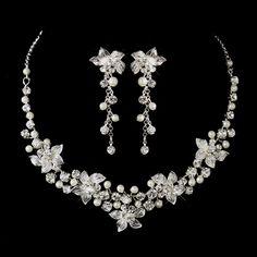 Just lovely! White Pearl and Rhinestone Wedding Jewelry Set Keywords: #weddingjewelry #jevelweddingplanning Follow Us: www.jevelweddingplanning.com www.facebook.com/jevelweddingplanning/