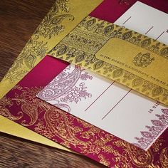Our Hima Indian wedding card with gold foil on dark fuschia paper. Stunning! A Splash Of Color With Elegant Foil – Indian Wedding Trend | Letterpress Wedding Invitation Blog