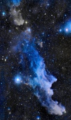 A frighteningly shaped reflection nebula, this cosmic crone is about 800 light-years away though. Its malevolent visage seems to glare toward nearby bright star Rigel in Orion, just off the right edge of this frame. More formally known as IC 2118, the interstellar cloud of dust and gas is nearly 70 light-years across, its dust grains reflecting Rigel's starlight. In this composite portrait, the nebula's color is caused not only by the star's intense bluish light but because...