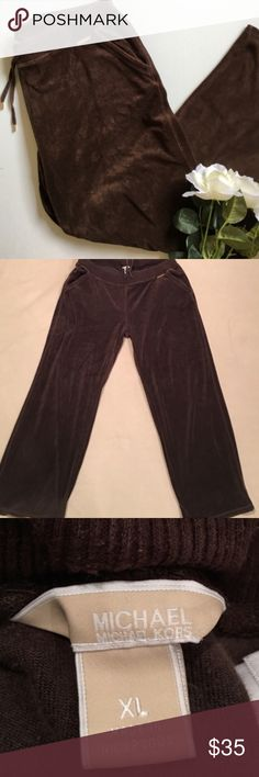 Michael Kors Sweat Pants •Dark Brown velour pants by Michael Kors  •Gold logo and hardware on ties  •Elastic stretch waistband with tie to make tighter, has pockets  •Laying flat:  19 inches across waist  31.5 inch inseam  11 inch front rise  16.5 inch back rise   •Soft, comfortable, and good used condition.   *Not all items are from smoke/pet free homes* Michael Kors Pants Track Pants & Joggers