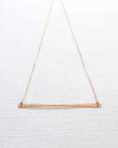 Rose Gold Hammered Bar Necklace by Olive Yew. Handmade hammered bar necklace is a cool, sleek, and modern piece of jewelry. A perfect layering necklace in gold, silver and rose gold.