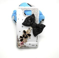 Handmade hard case for Samsung Galaxy S2: Bling black diamond bow with flowers (customized are welcome). $24.99, via Etsy.