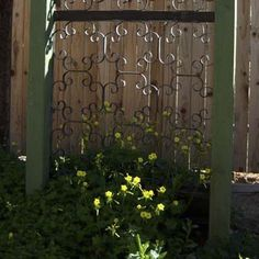 Upcycle a vintage metal window or door guard to serve as an ornate backdrop for climbers or potted plants. Simply mount the piece on a fence or wall and leave as is, or attach a pair of cast-iron flower-pot rings as an added flourish. | Photo: YOUR Old House | thisoldhouse.com
