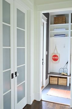 Tour Our Showhouse (frosted pantry doors with a mudroom beyond them)