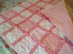 My second rag quilt! A baby blanket out of three layers of flannelette. The bright pink is the middle layer which gives this an overall pink border.