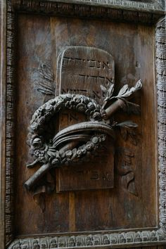 Details of a door of the Duomo. The inscription in hebrew should refer to one of the first commendments.