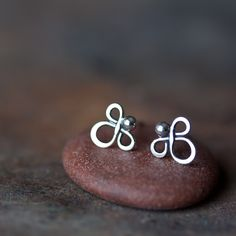 Hand crafted tiny sterling silver earrings - clover leaf shaped wire knot with a tiny silver ball attached to it. Some say they look like little angels :) - Earrings will be shipped with sterling silv