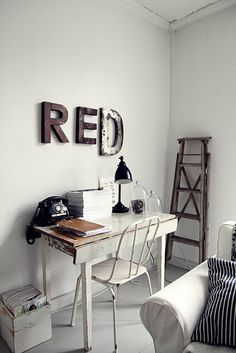 Modern and rustic latter / word wall art. RED made out of metal and other gorgeous features. Old vintage wooden ladder and telephone.