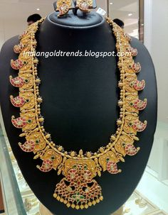 Latest Indian Gold and Diamond Jewellery Designs: Antique Ruby Mango Haram By Nalli Jewellers