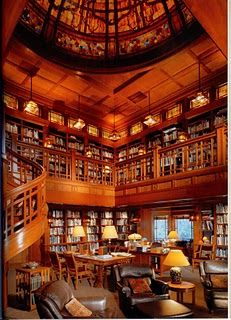 George Lucas built this incredible two-story library at Skywalker Ranch, a company retreat in Marin County, California. The library features a forty-foot stained glass dome, a circular staircase, beautiful wood paneling and trim work and of course, bookcases all around. The library houses 27,000 volumes. There are not many photographs of it, and visitors are rarely allowed.