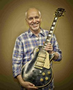 Peter Frampton holding his Gibson Les Paul that was presumed destroyed in a plane crash. He gets it back after 30 years. Peter Frampton comes alive . Peter Frampton, Guitar Art, Music Guitar, Cool Guitar, Music Songs, Frampton Comes Alive, Heavy Metal, Famous Guitars, Rock Poster