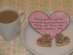 "Very cute Heart shaped cookies covered in 100's and 1000's and a message saying ""Thankyou for the hundreds and thousands of things you do for me! Happy Mother's Day! <3 it!"