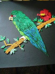 Quilled Parrot on a Branch - by: Maritza Burbuja Laboy