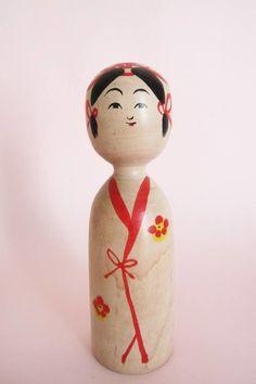 Kijiyama kokeshi doll by artisan Kominami Saburo, still making kokeshi at +80 years old! The wooden doll is wearing a simple kimono tied with (painted) ribbon.  (scheduled via http://www.tailwindapp.com?utm_source=pinterest&utm_medium=twpin&utm_content=post164467615&utm_campaign=scheduler_attribution)