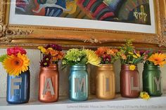 She puts mason jars upside down on her table. First she paints the bottoms, but then she does this on her mantel!