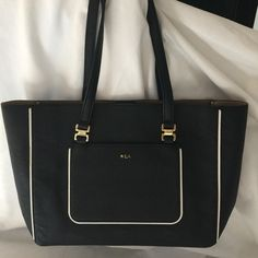 EUC RALPH LAUREN TOTE WITH POUCH This bag is so cute and come with matching cosmetic pouch. Excellent condition!!! Ralph Lauren Bags Totes
