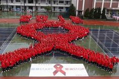 Students form a giant red ribbon during a publicity campaign to promote awareness about HIV/AIDS in Taipei. World AIDS Day will be observed on December Picture: REUTERS/Pichi Chuang Aids Awareness, World Aids Day, Blood Cells, Red Ribbon, Peace And Love, The Cure, Pictures, Hiv Aids, Badges