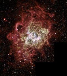 La nebulosa NGC 604,  uno dei più grandi ammassi  di stelle( almeno 200), raggruppate in una nuvola di gas incandescenti ampia 1.300 anni luce. - The nebula NGC 604, one of the largest clusters of stars (at least 200), grouped in a large cloud of glowing gas light 1300 years.