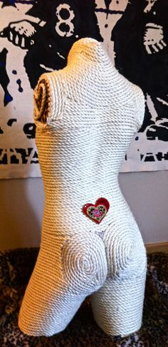Upcycled cat furniture scratching post made from an old manquin torso and backside!