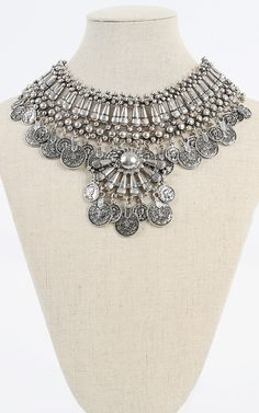 This coins pendant bib necklace is definitely eye catching and will give an outfit that cool edge. I MakeMeChic.com