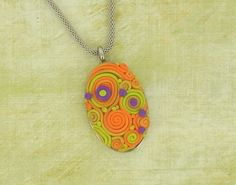 """""""Embroider"""" with clay strings and dots to make a simple but sophisticated pendant."""