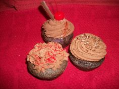 Different varieties of cherry chocolate cupcakes with a chocolate buttercream frosting