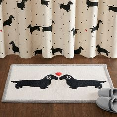 Create an eye-catching look in your bedroom with the HipStyle Olivia Collection. This unique dachshund design is featured on 100% cotton tufted fabrication for a textured look and feel. These two lovable dogs are sure to update your space.