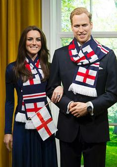 Wax figures of the Duke and Duchess of Cambridge are pictured wearing England supporters' hats, scarves and flags in support of England's participation in the Euro 2012, at Madame Tussauds, London, Friday, June 22, 2012.  (Jonathan Short/AP Photo)
